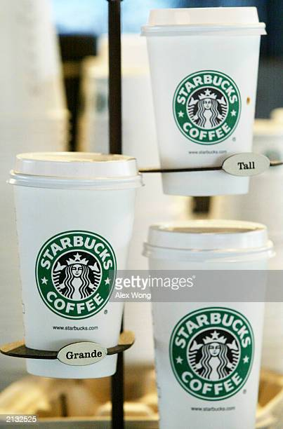 Starbucks coffee paper cups are displayed July 2 2003 in a Starbucks coffee shop at Dupont Circle in Washington DC Starbucks' stocks advanced $167 to...