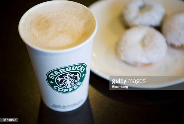 A Starbucks Corp new low calorie vanilla latte and mini sparkle doughnuts are arranged for a photograph in New York US on Wednesday Jan 13 2010 New...