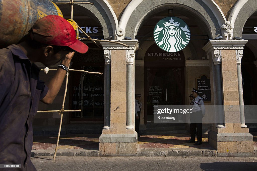 A Starbucks Corp. store stands in Mumbai, India, on Tuesday, Nov. 6, 2012. Reserve Bank of India Governor Duvvuri Subbarao lowered the RBI's forecast for India's gross domestic product growth in the year through March to 5.8 percent, the slowest in almost a decade, from 6.5 percent. Photographer: Brent Lewin/Bloomberg via Getty Images