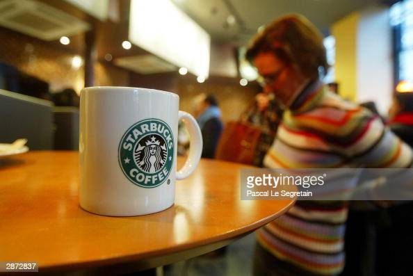 A starbucks cup is seen in the new Starbucks store the first ever in France as it opened for the public January 16 2004 in Paris Almost six years...