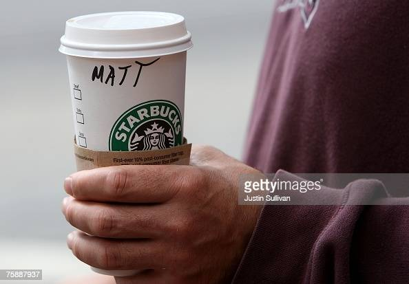 Starbucks customer holds a coffee drink as he leaves a Starbucks store July 31 2007 in San Francisco California With dairy prices reaching record...