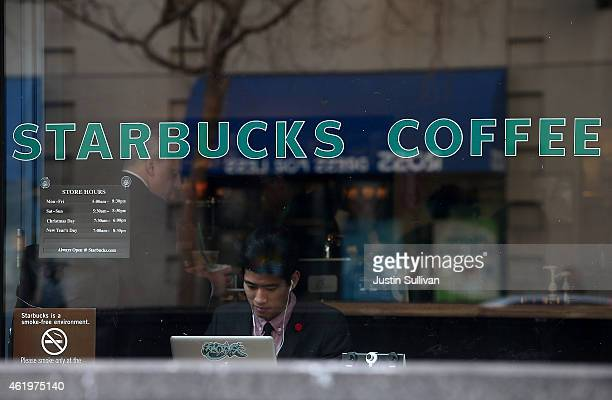 Starbucks customer works on his laptop inside a Starbucks Coffee shop on January 22 2015 in San Francisco California Starbucks will report first...