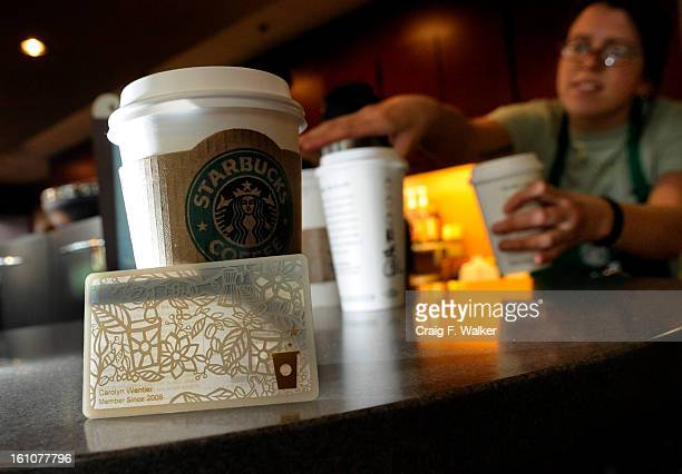 FEATURE_080708_CFW A Starbucks Gold Card is displayed at the 16th and Blake location in Denver CO The new rewards program is a loyalty card piloted...