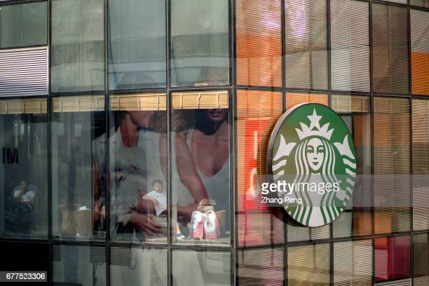 Starbucks logo on the glass wall of a building Since June 1st 2017 the fulltime employees of Starbucks in Chinese market who have worked for two...