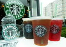 Starbucks' new iced coffee and tea beverages are displayed during a promotion June 2 2003 outside a Starbucks coffee shop at Dupont Circle in...