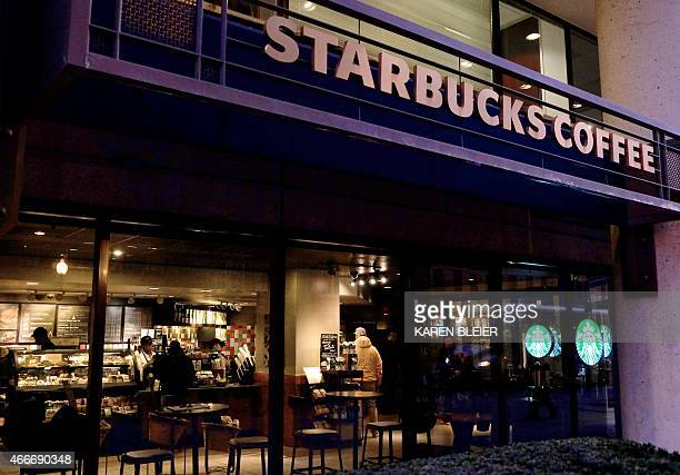 A Starbucks store is seen March 18 2015 in Washington DC Starbucks customers can now add discussion about racism to their latte order In an...