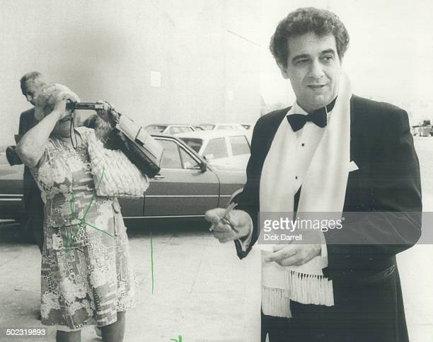 Stardom has its rewards Opera tenor Placido Domingo stopped long enough to sign autographs and give fan Mildred Collis the thrill of snapping his...