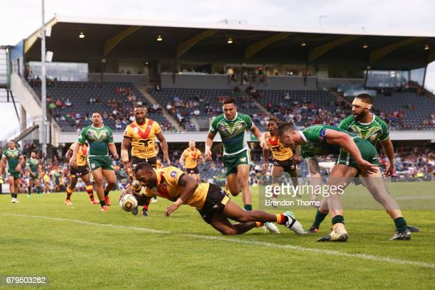 Stargroth Amean of PNG dives to score a try during the 2017 Pacific Test Invitational match between Cook Islands and Papua New Guinea at Campbelltown...