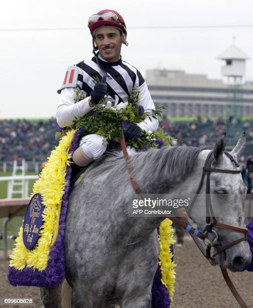 Starine heads for the winner's circle as jockey John Velazques smiles and gives the thumbsup after winning the Breeders' Cup Filly Mare Turf race 26...