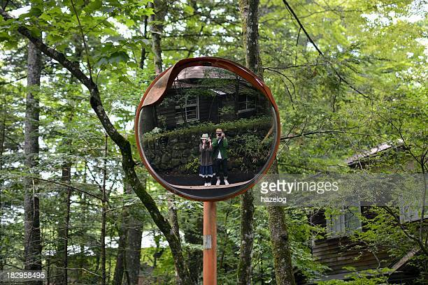 Staring at ourself in convex mirror at road curve