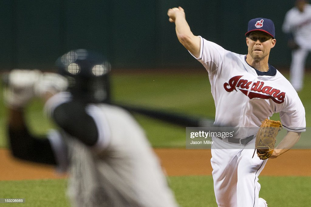 Staring pitcher Corey Kluber #28 of the Cleveland Indians pitches to <a gi-track='captionPersonalityLinkClicked' href=/galleries/search?phrase=Dewayne+Wise&family=editorial&specificpeople=704740 ng-click='$event.stopPropagation()'>Dewayne Wise</a> #28 of the Chicago White Sox during the first inning at Progressive Field on October 1, 2012 in Cleveland, Ohio.