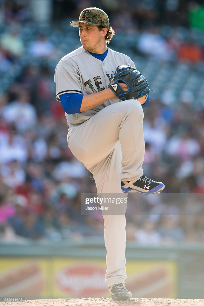 Staring pitcher <a gi-track='captionPersonalityLinkClicked' href=/galleries/search?phrase=Derek+Holland+-+Baseball+Player&family=editorial&specificpeople=8003703 ng-click='$event.stopPropagation()'>Derek Holland</a> #45 of the Texas Rangers pitches during the first inning against the Cleveland Indians at Progressive Field on May 30, 2016 in Cleveland, Ohio.
