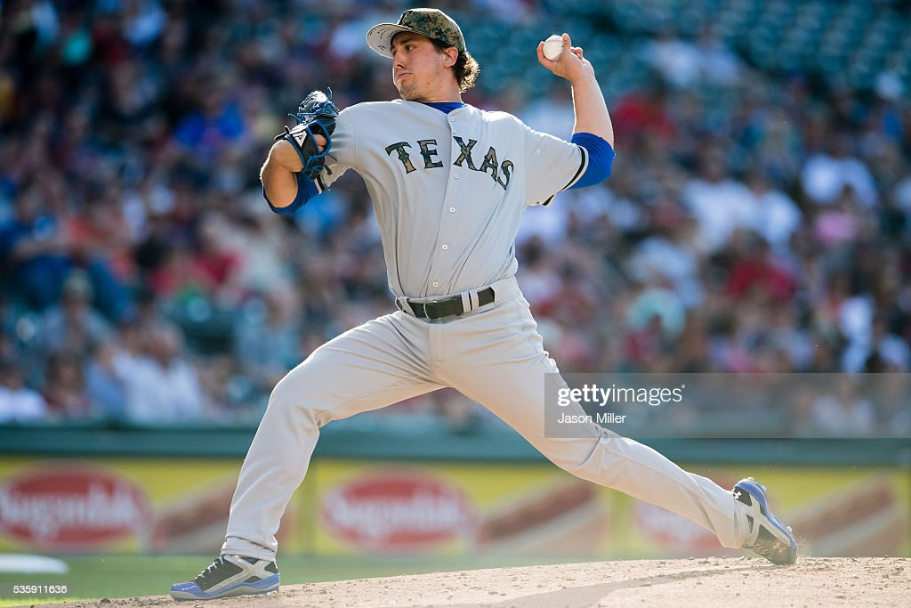 Staring pitcher <a gi-track='captionPersonalityLinkClicked' href=/galleries/search?phrase=Derek+Holland+-+Jugador+de+b%C3%A9isbol&family=editorial&specificpeople=8003703 ng-click='$event.stopPropagation()'>Derek Holland</a> #45 of the Texas Rangers pitches during the first inning against the Cleveland Indians at Progressive Field on May 30, 2016 in Cleveland, Ohio.
