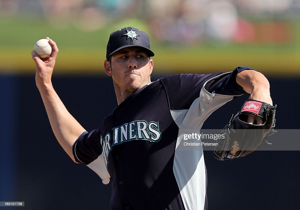 Staring pitcher <a gi-track='captionPersonalityLinkClicked' href=/galleries/search?phrase=Jon+Garland&family=editorial&specificpeople=209155 ng-click='$event.stopPropagation()'>Jon Garland</a> #20 of the Seattle Mariners pitches against the Colorado Rockies during the spring training game at Peoria Stadium on March 4, 2013 in Peoria, Arizona.