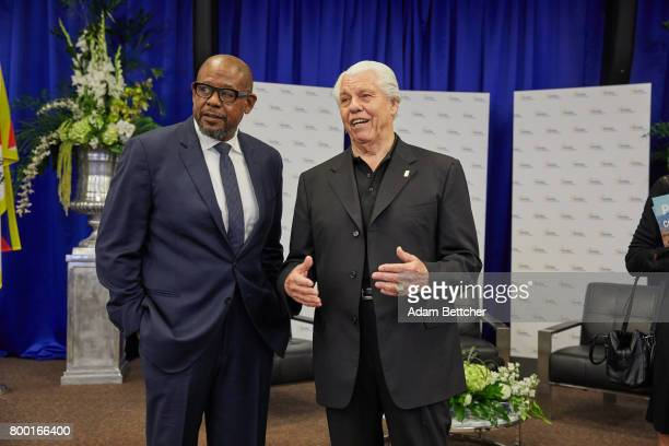 Starkey founder Bill Austin and actor Forest Whitaker look at the room before His Holiness the XIVth Dalai Lama speaks at the Starkey Hearing...
