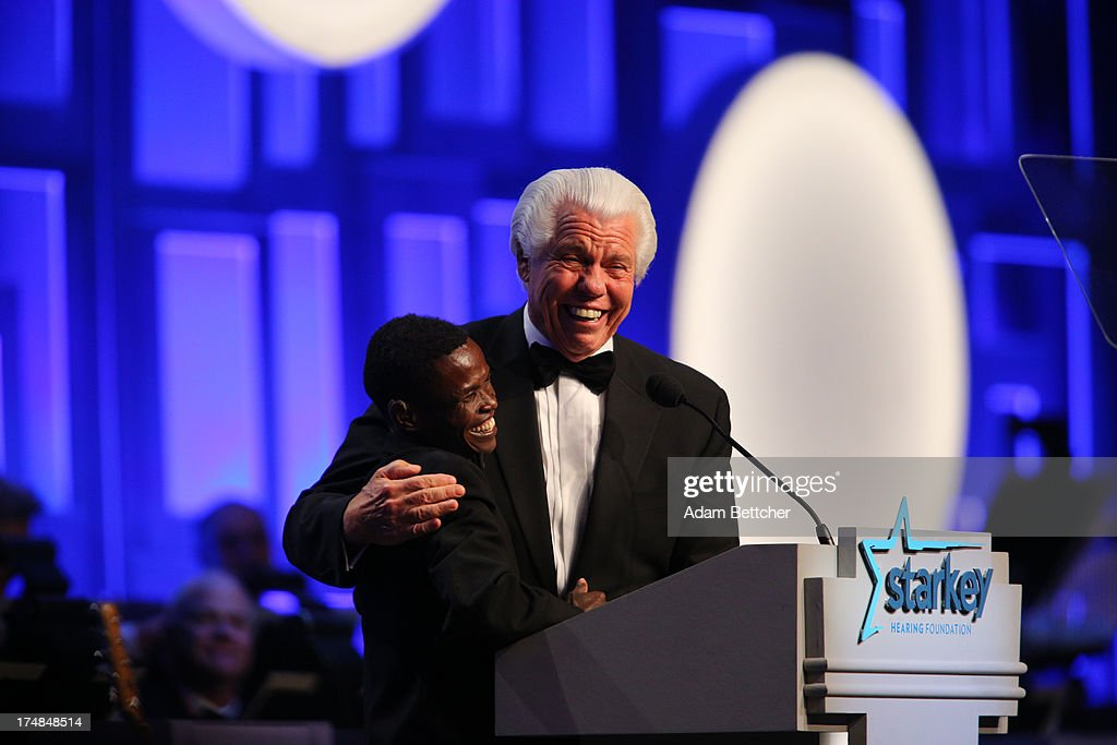 Starkey Founder Bill Austin hugs a special guest from Ethiopia during the 2013 Starkey Hearing Foundation's 'So the World May Hear' Awards Gala on July 28, 2013 in St. Paul, Minnesota.
