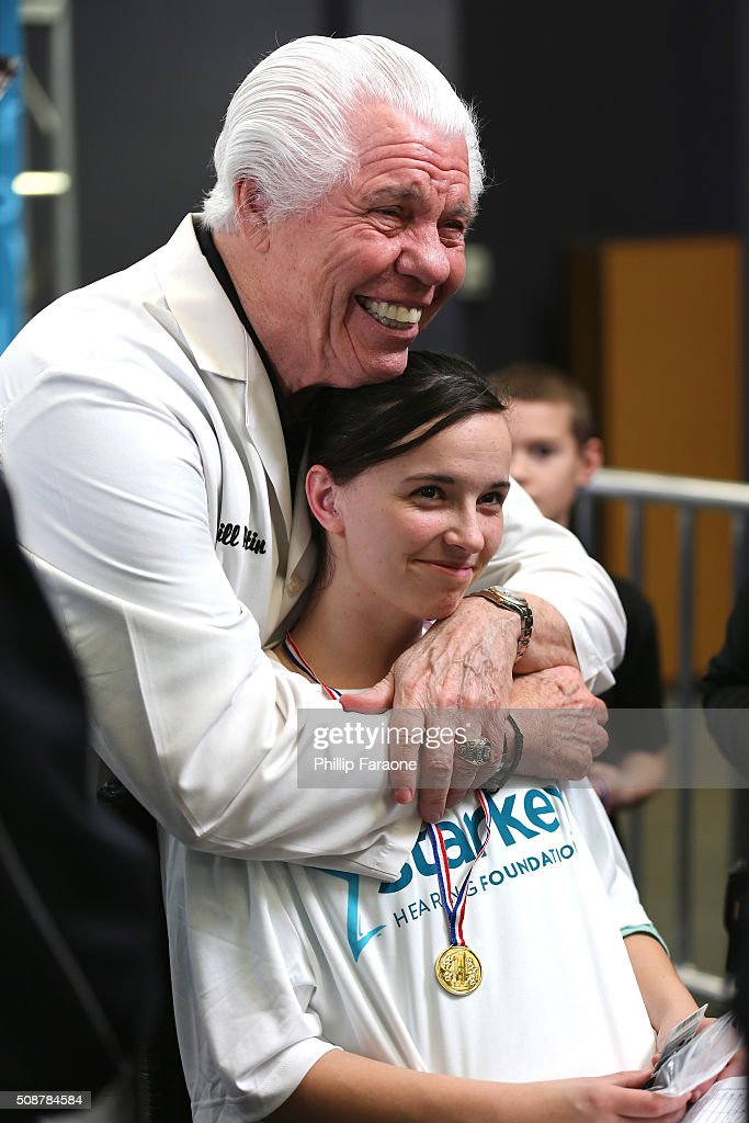 Dr. Bill Austin hugs a patient at the Starkey Hearing Foundation hearing mission during Super Bowl weekend 2016 at San Francisco State University on February 6, 2016 in San Francisco, California.