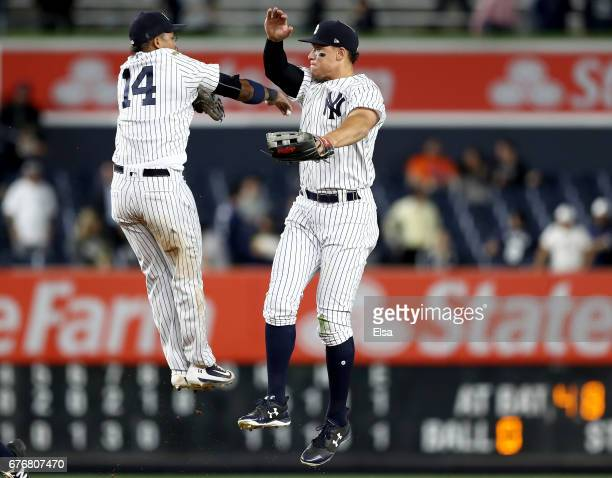Starlin Castro and Aaron Judge of the New York Yankees celebrate the 115 win over the Toronto Blue Jays on May 2 2017 at Yankee Stadium in the Bronx...