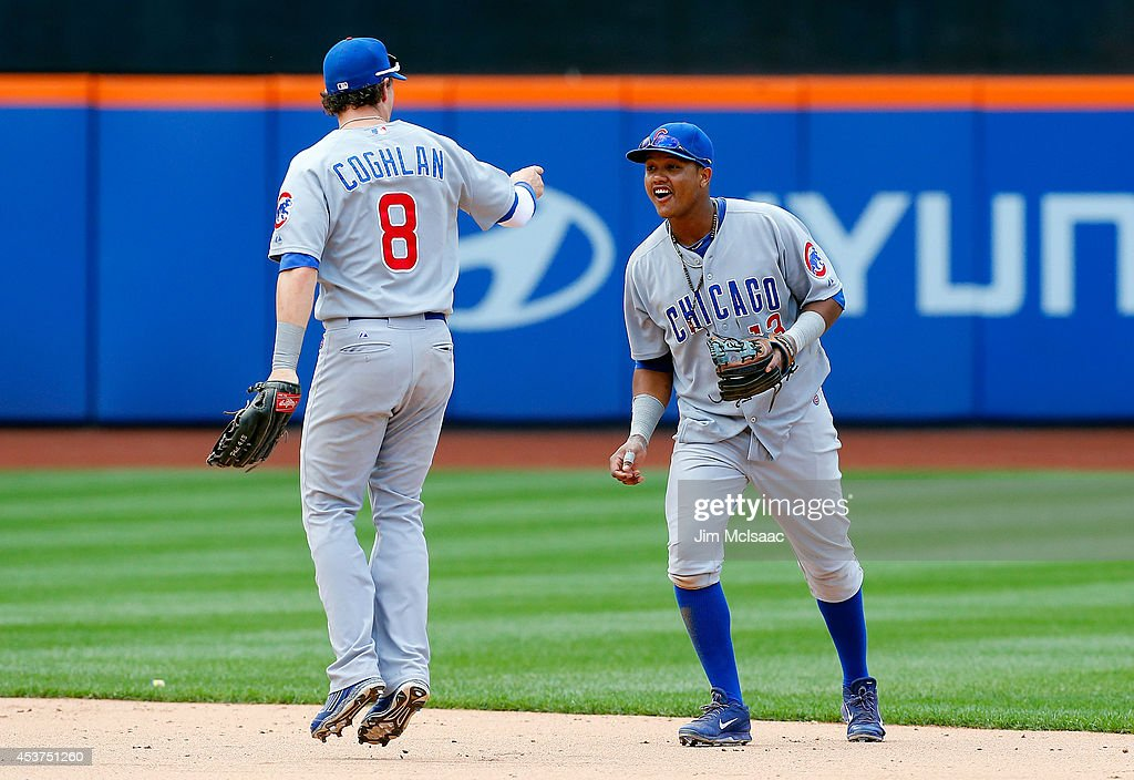 <a gi-track='captionPersonalityLinkClicked' href=/galleries/search?phrase=Starlin+Castro&family=editorial&specificpeople=5970945 ng-click='$event.stopPropagation()'>Starlin Castro</a> #13 and <a gi-track='captionPersonalityLinkClicked' href=/galleries/search?phrase=Chris+Coghlan&family=editorial&specificpeople=4391543 ng-click='$event.stopPropagation()'>Chris Coghlan</a> #8 of the Chicago Cubs celebrate after defeating the New York Mets at Citi Field on August 17, 2014 in the Flushing neighborhood of the Queens borough of New York City.