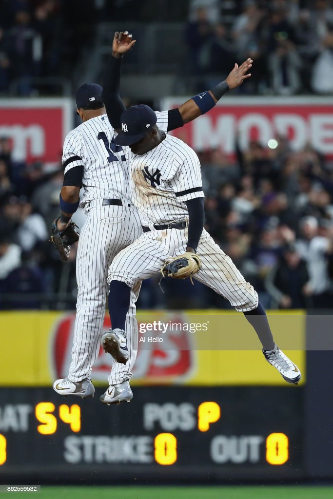 Starlin Castro #14 and Didi Gregorius #18 of the New York Yankees celebrate after defeating the Houston Astros in Game Four of the American League Championship Series at Yankee Stadium on October 17, 2017 in the Bronx borough of New York City. The New York Yankees defeated the Houston Astros 6-4.