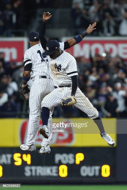 Starlin Castro and Didi Gregorius of the New York Yankees celebrate after defeating the Houston Astros in Game Four of the American League...