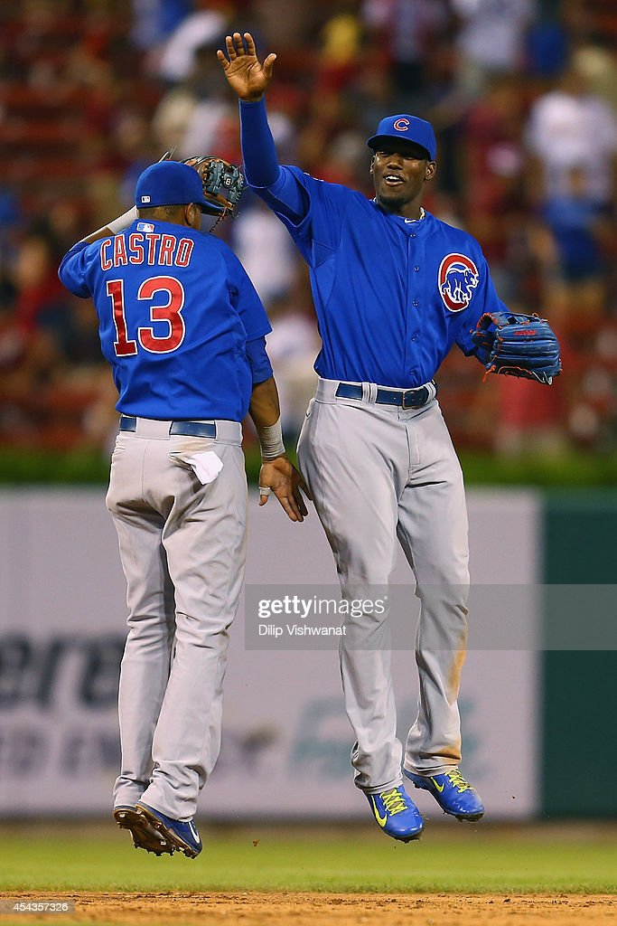 <a gi-track='captionPersonalityLinkClicked' href=/galleries/search?phrase=Starlin+Castro&family=editorial&specificpeople=5970945 ng-click='$event.stopPropagation()'>Starlin Castro</a> #13 and <a gi-track='captionPersonalityLinkClicked' href=/galleries/search?phrase=Jorge+Soler&family=editorial&specificpeople=10527376 ng-click='$event.stopPropagation()'>Jorge Soler</a> #68 celebrate after beating the St. Louis Cardinals at Busch Stadium on August 29, 2014 in St. Louis, Missouri. The Cubs beat the Cardinals 7-2.
