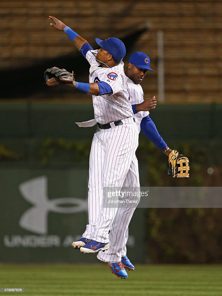 Starlin Castro #13 (L) and Jorge Soler #68 of the Chicago Cubs celebrate a win over the New York Mets at Wrigley Field on May 12, 2015 in Chicago, Illinois. The Cubs defeated the Mets 6-1.