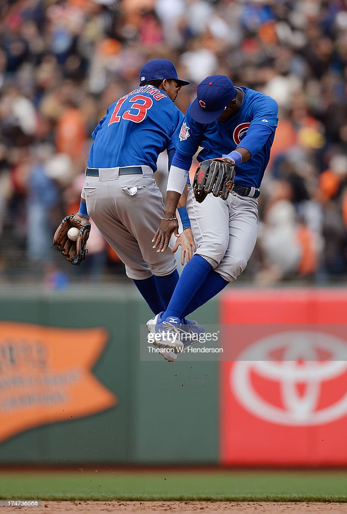 Starlin Castro #13 and Junior Lake #21 of the Chicago Cubs celebrate defeating the San Francisco Giants 2-1 at AT&T Park on July 28, 2013 in San Francisco, California.