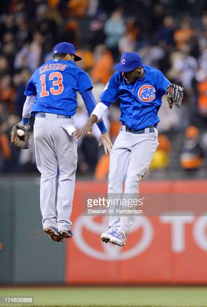 Starlin Castro and Junior Lake of the Chicago Cubs celebrates defeating the San Francisco Giants 32 at ATT Park on July 26 2013 in San Francisco...