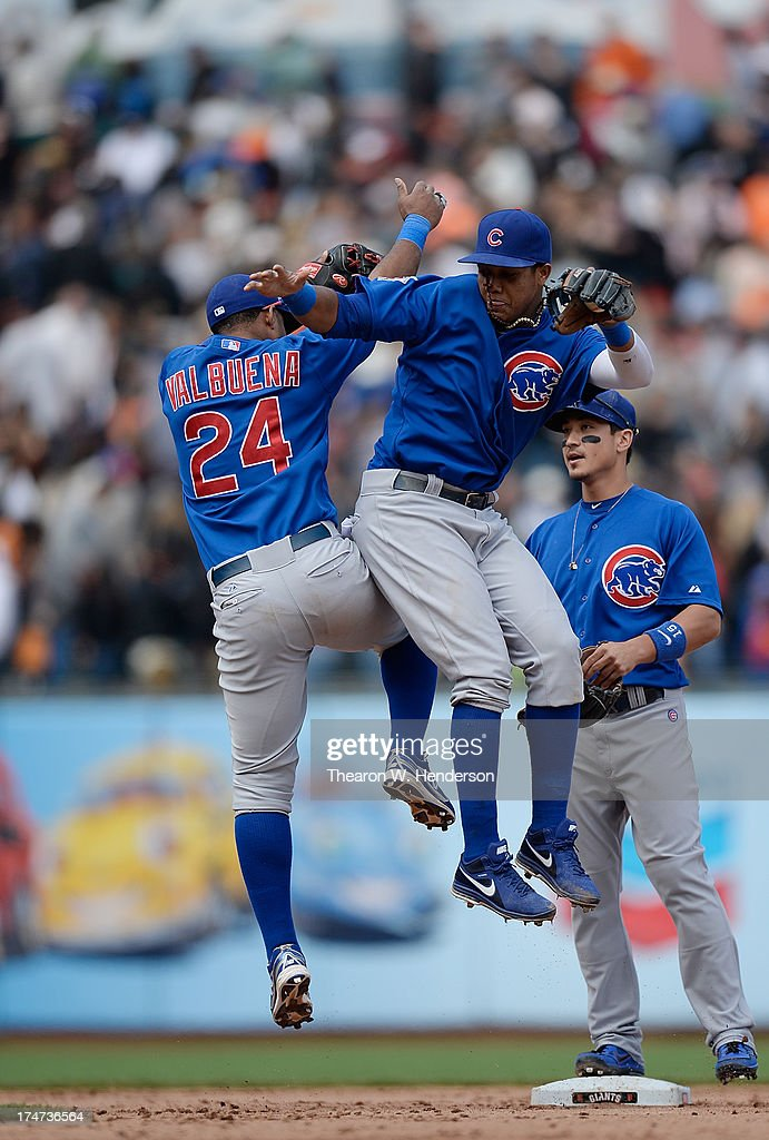 Starlin Castro #13 and Luis Valbuena #24 of the Chicago Cubs celebrate defeating the San Francisco Giants 2-1 at AT&T Park on July 28, 2013 in San Francisco, California.