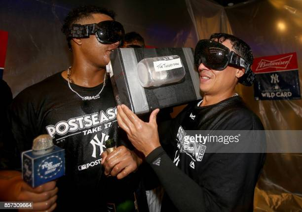Starlin Castro and Ronald Torreyes of the New York Yankees pretend to interview teammates in the clubhouse after the win over the Minnesota Twins...