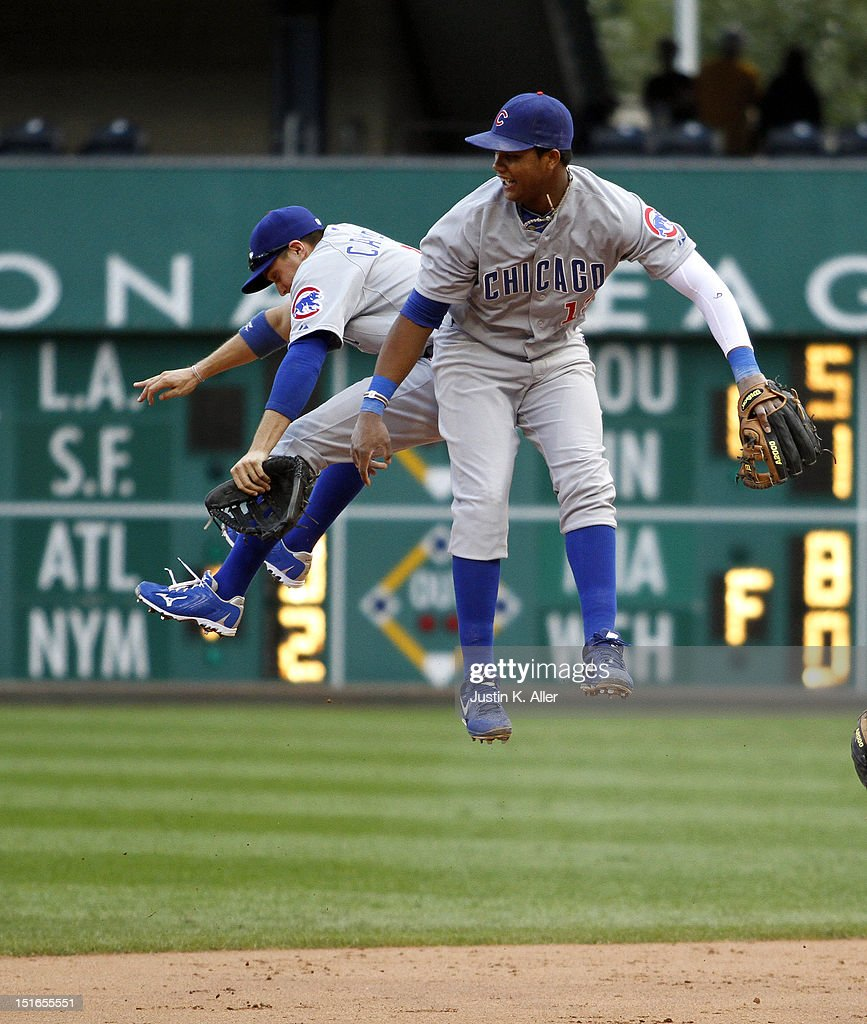 <a gi-track='captionPersonalityLinkClicked' href=/galleries/search?phrase=Starlin+Castro&family=editorial&specificpeople=5970945 ng-click='$event.stopPropagation()'>Starlin Castro</a> #13 and <a gi-track='captionPersonalityLinkClicked' href=/galleries/search?phrase=Tony+Campana&family=editorial&specificpeople=7800014 ng-click='$event.stopPropagation()'>Tony Campana</a> #1 of the Chicago Cubs celebrate after defeating the Pittsburgh Pirates during the game on September 9, 2012 at PNC Park in Pittsburgh, Pennsylvania.