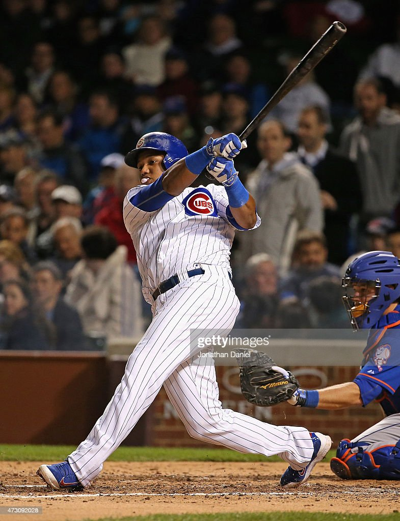 Starlin Castro #13 of the Chicago Cubs blows a bubble while hitting a run-scoring double in the 6th inning against the New York Mets at Wrigley Field on May 12, 2015 in Chicago, Illinois.
