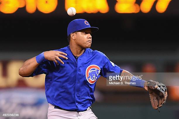 Starlin Castro of the Chicago Cubs bobbles a ball hit by Matt Holliday of the St Louis Cardinals in the third inning during game one of the National...
