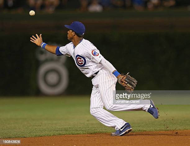 Starlin Castro of the Chicago Cubs bobbles the ball against the Milwaukee Brewers at Wrigley Field on August 27 2012 in Chicago Illinois