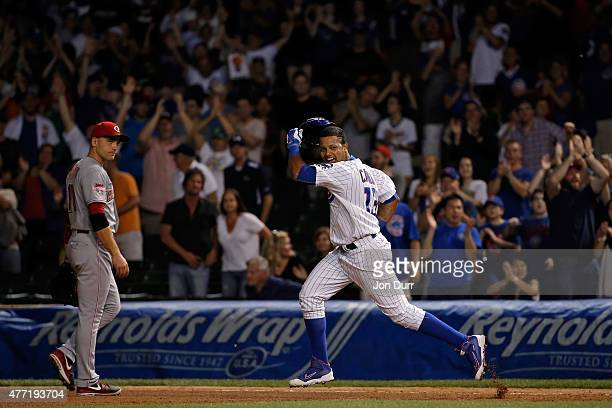 Starlin Castro of the Chicago Cubs celebrates after hitting a walkoff one run RBI single against the Cincinnati Reds during the eleventh inning as...