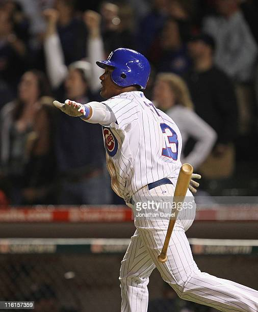 Starlin Castro of the Chicago Cubs celebrates his gamewinning hit against the Milwaukee Brewers at Wrigley Field on June 14 2011 in Chicago Illinois...