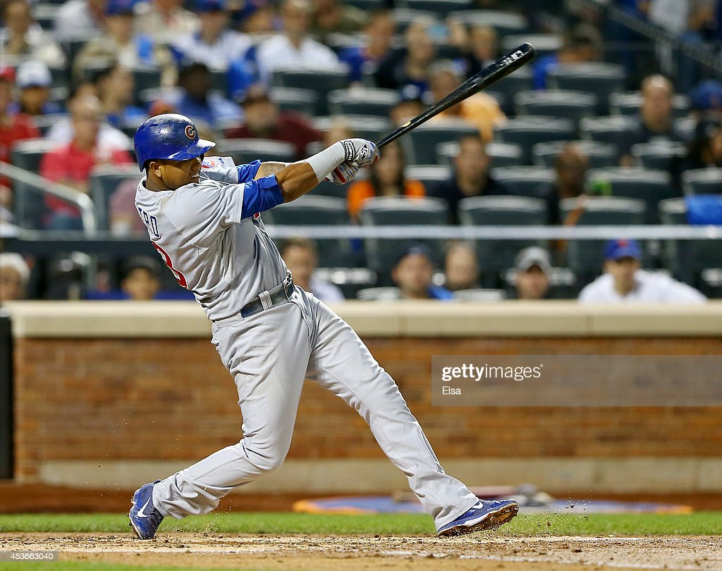 <a gi-track='captionPersonalityLinkClicked' href=/galleries/search?phrase=Starlin+Castro&family=editorial&specificpeople=5970945 ng-click='$event.stopPropagation()'>Starlin Castro</a> #13 of the Chicago Cubs drives in Javier Baez in the third inning against the New York Mets on August 15, 2014 at Citi Field in the Flushing neighborhood of the Queens borough of New York City.