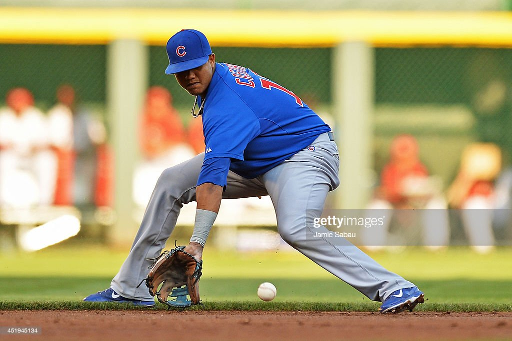 Starlin Castro #13 of the Chicago Cubs fields a ground ball in the first inning against the Cincinnati Reds at Great American Ball Park on July 9, 2014 in Cincinnati, Ohio. Cincinnati defeated Chicago 4-1.