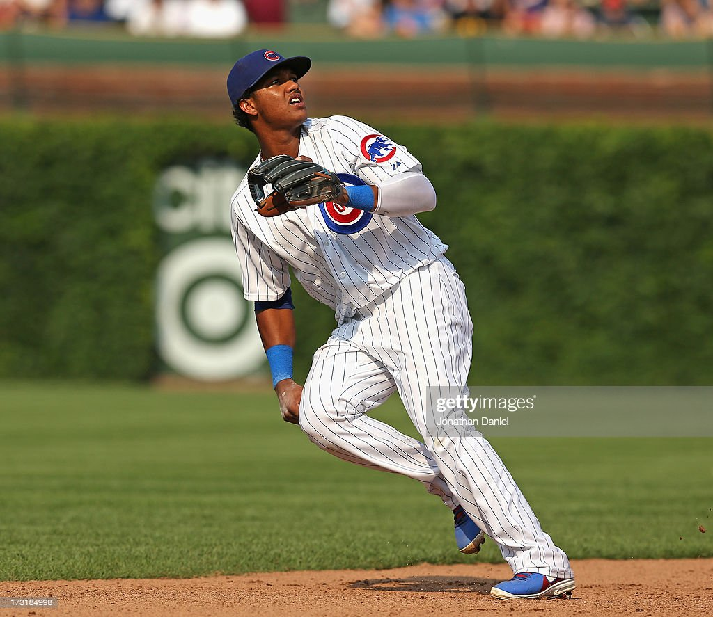 Starlin Castro #13 of the Chicago Cubs follows the flight of the ball against the Pittsburgh Pirates at Wrigley Field on July 5, 2013 in Chicago, Illinois. The Pirates defeated the Cubs 6-2.