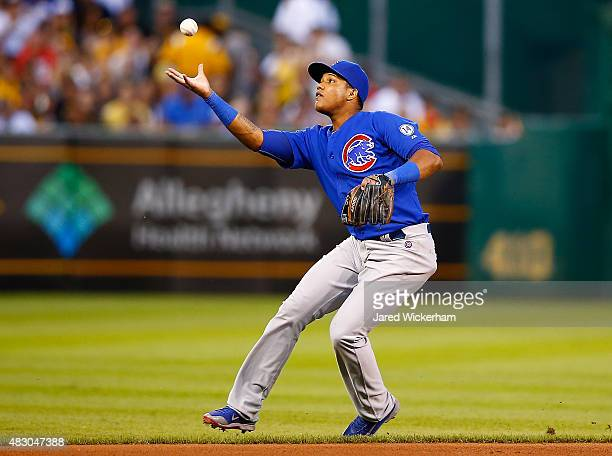 Starlin Castro of the Chicago Cubs grabs a ball with his bare hand against the Pittsburgh Pirates during the game at PNC Park on August 5 2015 in...