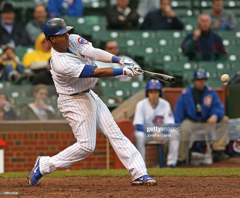 <a gi-track='captionPersonalityLinkClicked' href=/galleries/search?phrase=Starlin+Castro&family=editorial&specificpeople=5970945 ng-click='$event.stopPropagation()'>Starlin Castro</a> #13 of the Chicago Cubs hits a double in the 6th inning against the Texas Rangers at Wrigley Field on April 18, 2013 in Chicago, Illinois. The Cubs defeated the Rangers 6-2.