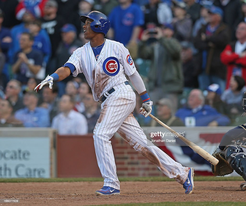 <a gi-track='captionPersonalityLinkClicked' href=/galleries/search?phrase=Starlin+Castro&family=editorial&specificpeople=5970945 ng-click='$event.stopPropagation()'>Starlin Castro</a> #13 of the Chicago Cubs hits a long fly ball with the bases loaded in the 9th inning to end the Opening Day game against the Milwaukee Brewers at Wrigley Field on April 8, 2013 in Chicago, Illinois. The Brewers defeated the Cubs 7-4.