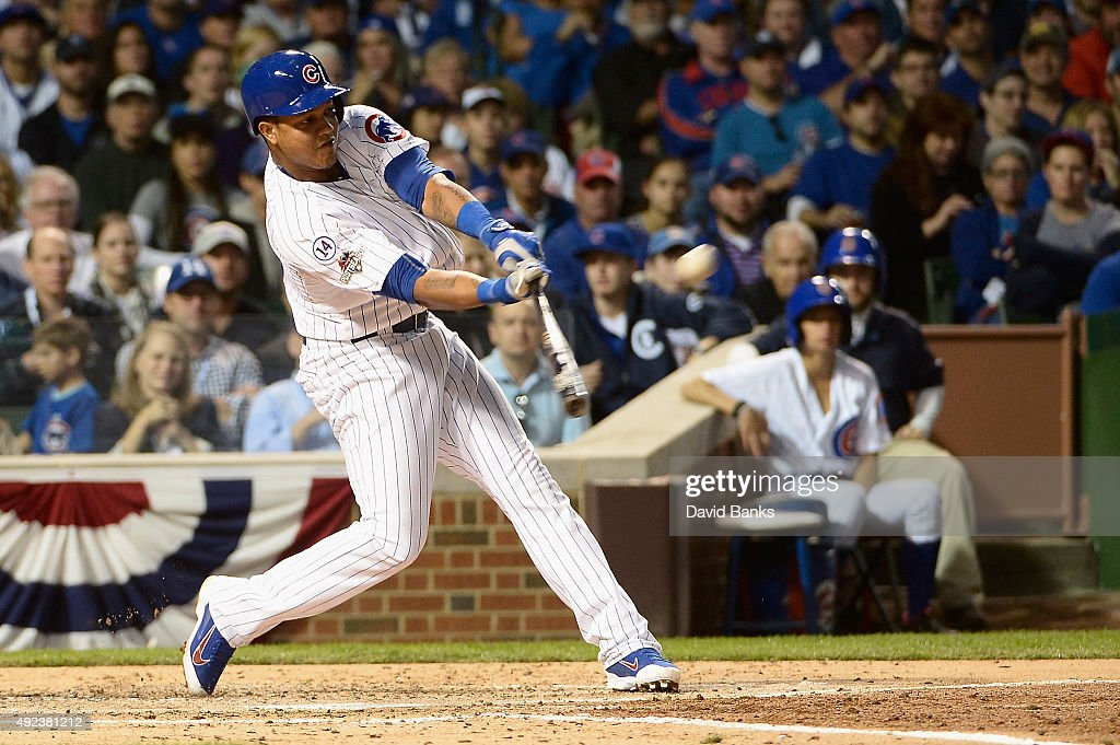 <a gi-track='captionPersonalityLinkClicked' href=/galleries/search?phrase=Starlin+Castro&family=editorial&specificpeople=5970945 ng-click='$event.stopPropagation()'>Starlin Castro</a> #13 of the Chicago Cubs hits a solo home run in the fourth inning against the St. Louis Cardinals during game three of the National League Division Series at Wrigley Field on October 12, 2015 in Chicago, Illinois.