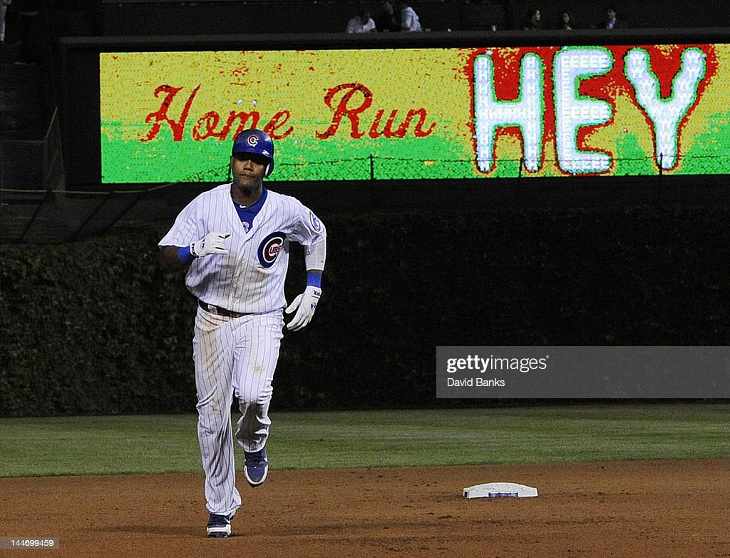 <a gi-track='captionPersonalityLinkClicked' href=/galleries/search?phrase=Starlin+Castro&family=editorial&specificpeople=5970945 ng-click='$event.stopPropagation()'>Starlin Castro</a> #13 of the Chicago Cubs hits a solo home run in the seventh inning against the Philadelphia Phillies on May 17, 2012 at Wrigley Field in Chicago, Illinois.