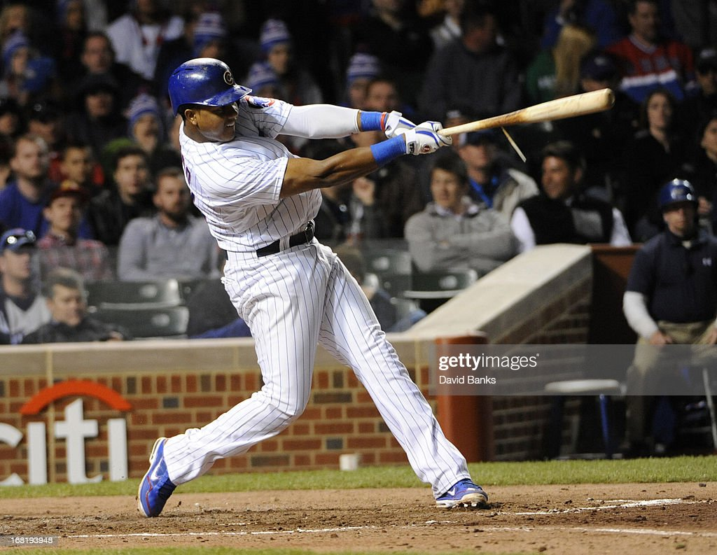 <a gi-track='captionPersonalityLinkClicked' href=/galleries/search?phrase=Starlin+Castro&family=editorial&specificpeople=5970945 ng-click='$event.stopPropagation()'>Starlin Castro</a> #13 of the Chicago Cubs hits a two RBI single against the Texas Rangers during the fourth inning on May 6, 2013 at Wrigley Field in Chicago, Illinois.