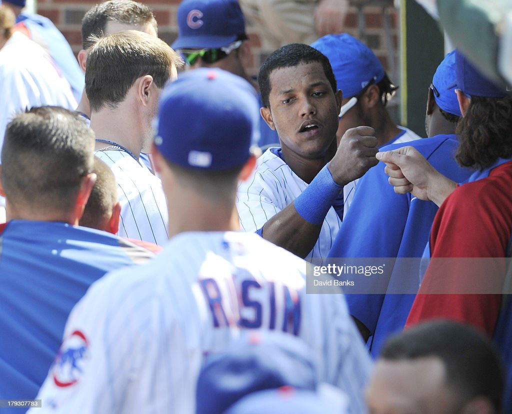 <a gi-track='captionPersonalityLinkClicked' href=/galleries/search?phrase=Starlin+Castro&family=editorial&specificpeople=5970945 ng-click='$event.stopPropagation()'>Starlin Castro</a> #13 of the Chicago Cubs is greeted after scoring against the Philadelphia Phillies during the third inning on September 1, 2013 at Wrigley Field in Chicago, Illinois.