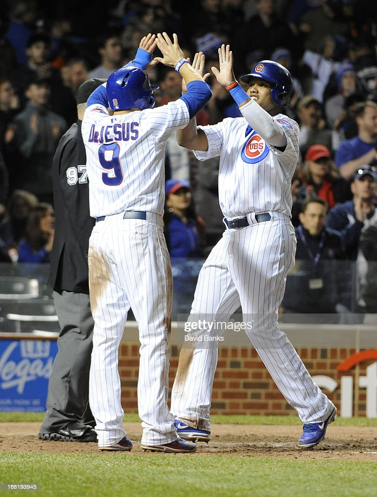 <a gi-track='captionPersonalityLinkClicked' href=/galleries/search?phrase=Starlin+Castro&family=editorial&specificpeople=5970945 ng-click='$event.stopPropagation()'>Starlin Castro</a> #13 of the Chicago Cubs is greeted by <a gi-track='captionPersonalityLinkClicked' href=/galleries/search?phrase=David+DeJesus&family=editorial&specificpeople=206765 ng-click='$event.stopPropagation()'>David DeJesus</a> #9 after scoring against the Texas Rangers during the fourth inning on May 6, 2013 at Wrigley Field in Chicago, Illinois.