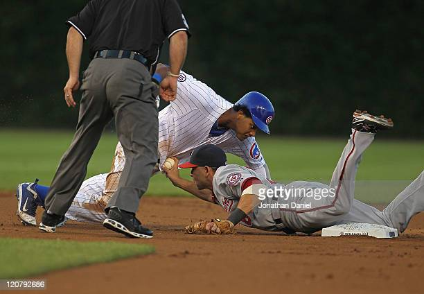 Starlin Castro of the Chicago Cubs is tagged out at second base by Danny Espinosa of the Washington Nationals in the 1st inning at Wrigley Field on...