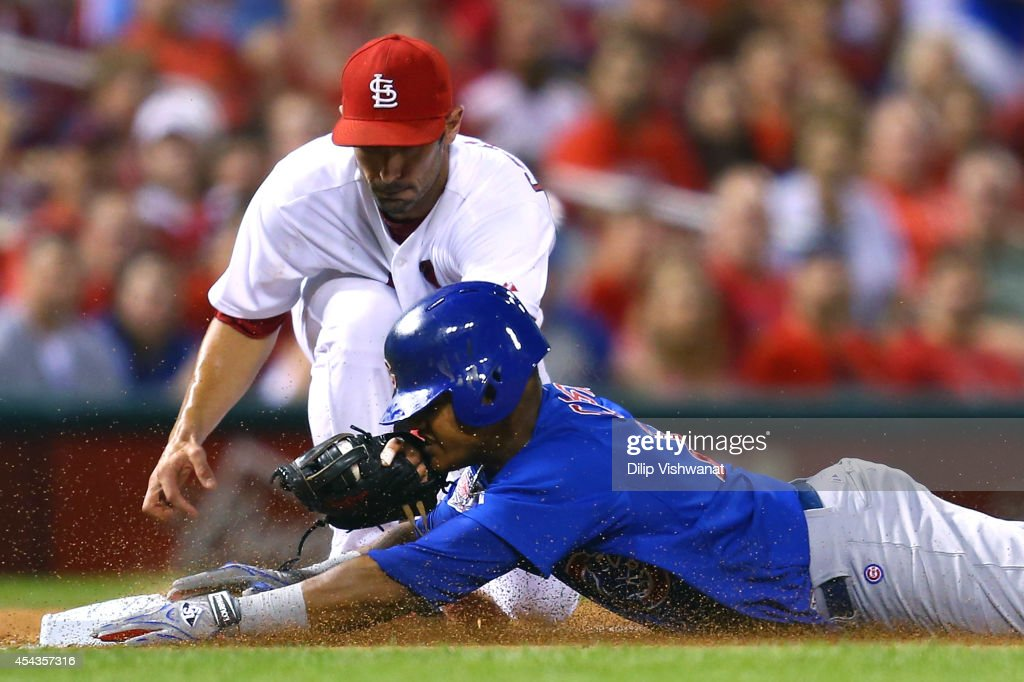 <a gi-track='captionPersonalityLinkClicked' href=/galleries/search?phrase=Starlin+Castro&family=editorial&specificpeople=5970945 ng-click='$event.stopPropagation()'>Starlin Castro</a> #13 of the Chicago Cubs is tagged out at third base by Matt Carpenter #13 of the St. Louis Cardinals while trying to run out a triple in the sixth inning at Busch Stadium on August 29, 2014 in St. Louis, Missouri. The Cubs beat the Cardinals 7-2.